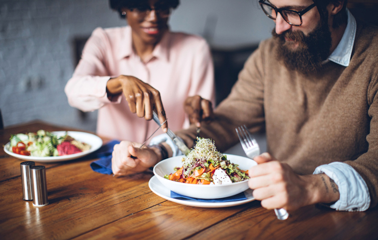 Couple at home sharing dinner on the Flexitarian Diet meal plan