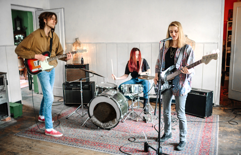 Band playing music at home to illustrate the brain benefits of performing and making music