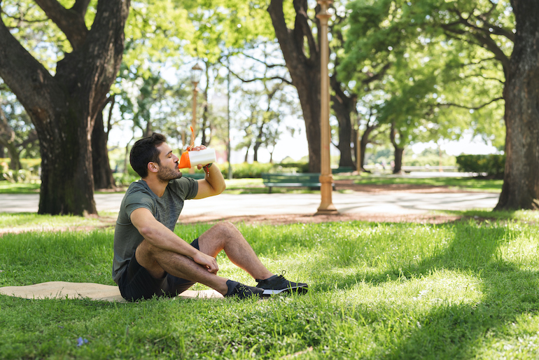 Man drinking protein shake for muscle recovery and repair