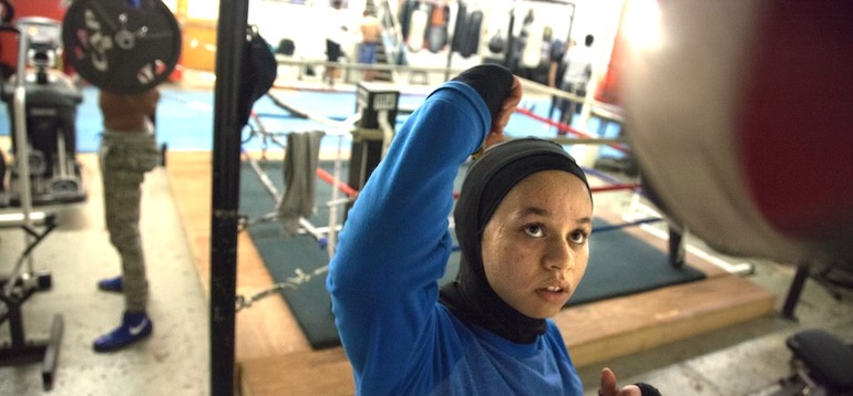 Boxer Amaiya Zafar punching a bag at boxing gym, powered by healthy eats from her daily food diary