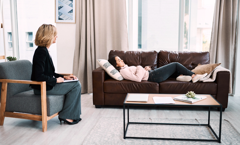 Woman at therapist's office getting hypnotized to help her lose weight