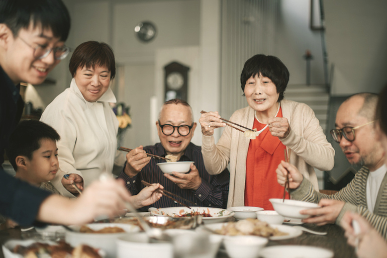 Asian family with seniors eating dinner to benefit from human connection, family ties, and healthy eating habits