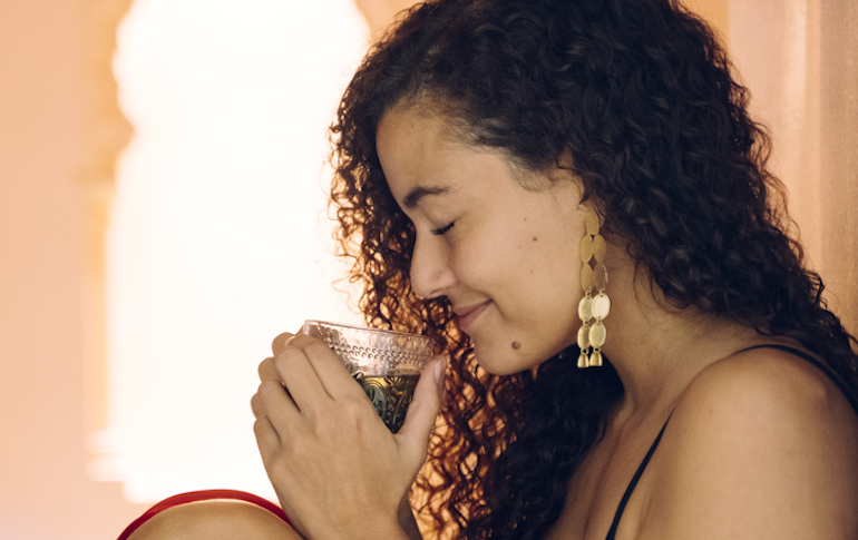 Woman drinking peppermint tea to reduce bloating and gas