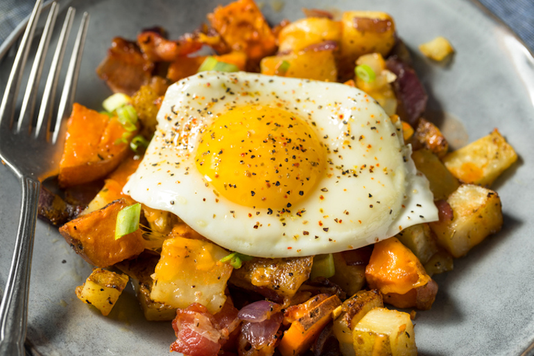 Sweet potato hash with an egg and added protein